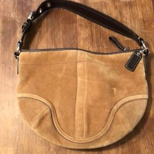 Beautiful medium size coach suede leather tan bag
